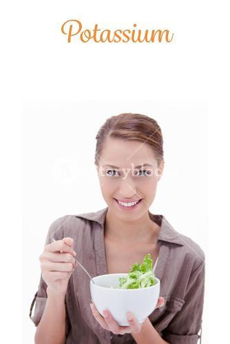 Potassium against woman with bowl of salad