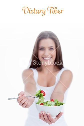 Dietary fiber against delicious salad being eaten by a young woman