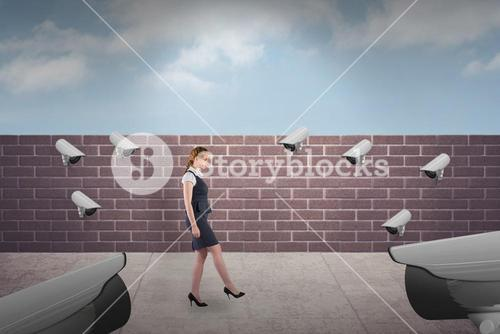 Composite image of redhead businesswoman stepping