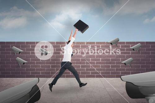 Composite image of businessman leaping with his briefcase