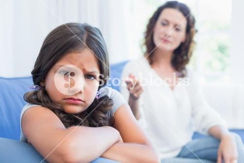 Upset mother looking at her daughter