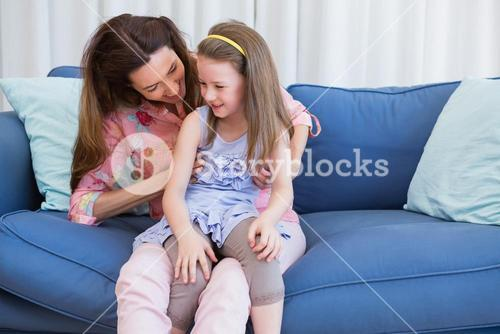 Mother and daughter on the couch