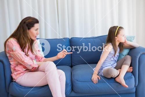 Mother scolding her naughty daughter