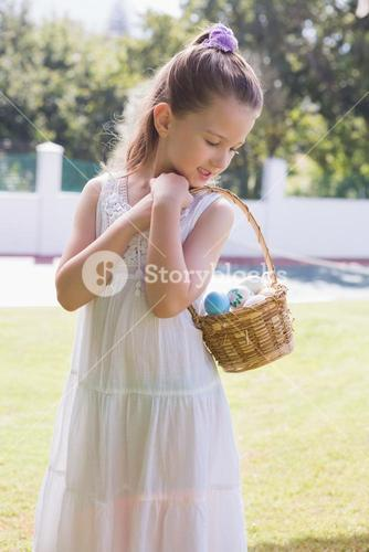 Little girl collecting easter eggs