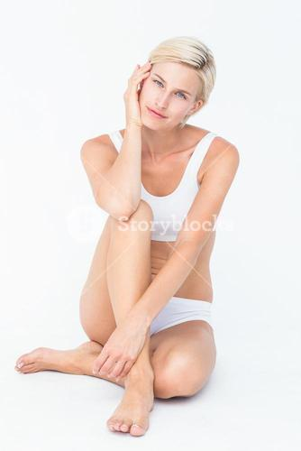 Peaceful woman sitting on the floor
