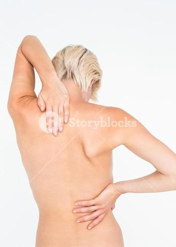 Pretty woman suffering from back pain