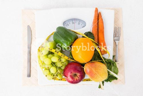 Weighing scales with fruits and vegetables
