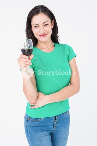 Smiling brunette holding glass of red wine