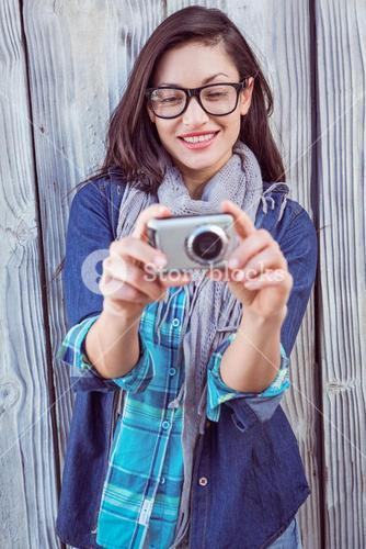 Happy hipster taking a picture