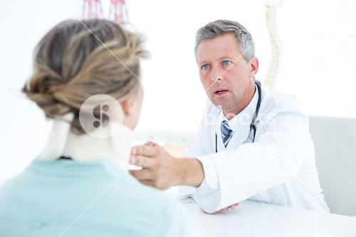 Doctor checking neck brace of his patient