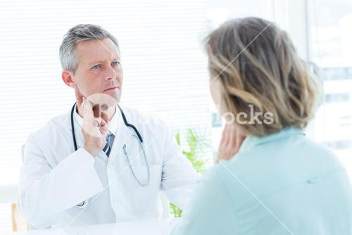 Doctor touching his pulse