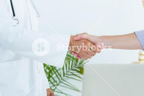 Doctor shaking hand of his patient