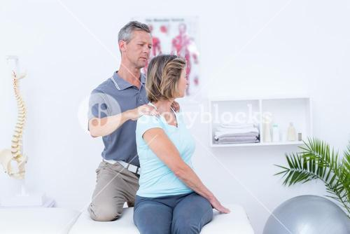 Doctor examining his patient neck