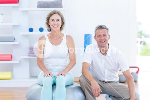 Doctor and patient smiling at camera