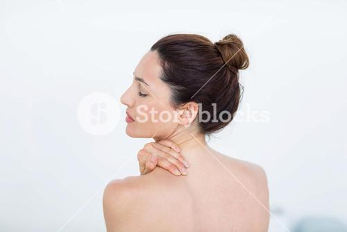 Woman touching her shoulder