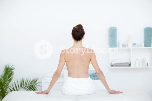 Woman sitting on massage table