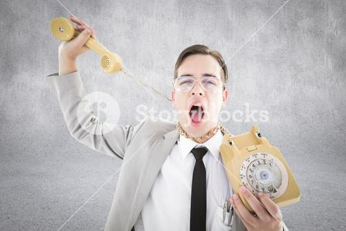 Composite image of geeky businessman being strangled by phone cord