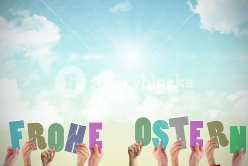 Composite image of hands holding up frohe ostern