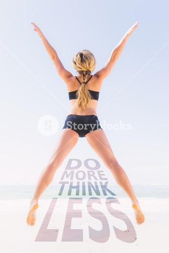 Composite image of fit blonde jumping on the beach with arms outstretched