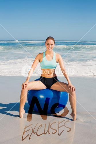 Composite image of fit woman sitting on exercise ball at the beach