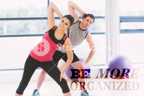 Composite image of two people doing power fitness exercise at yoga class