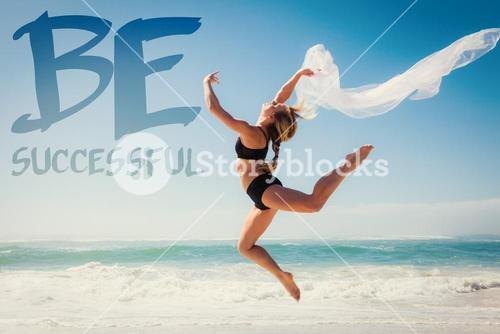 Composite image of fit blonde jumping gracefully with scarf on the beach