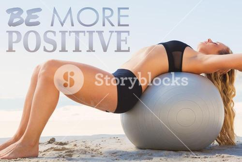 Composite image of fit blonde stretching her back on exercise ball at the beach