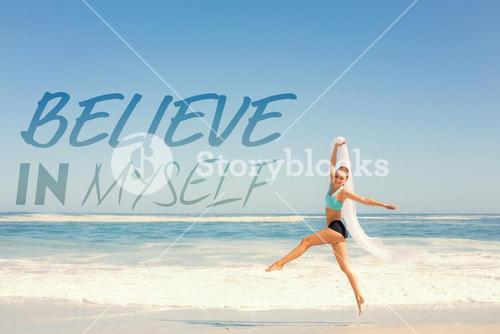 Composite image of fit woman jumping gracefully on the beach with scarf