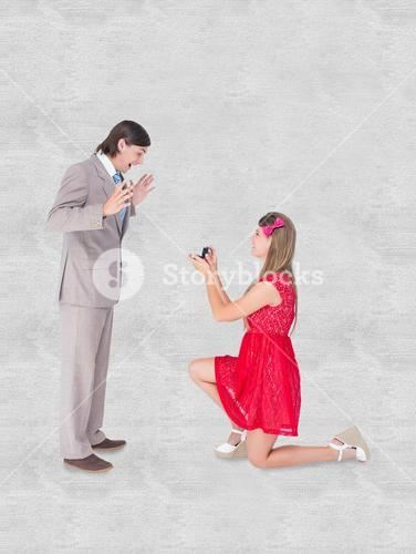 Composite image of pretty hipster on bended knee doing a marriage proposal to her boyfriend