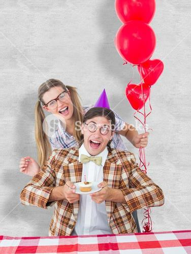 Composite image of geeky hipsters celebrating birthday