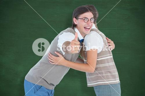 Composite image of geeky hipster couple hugging