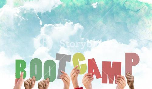 Composite image of hands holding up boot camp