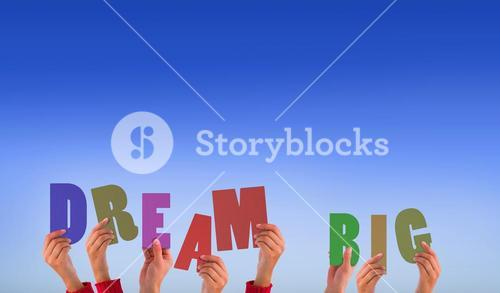 Composite image of hands holding up dream big