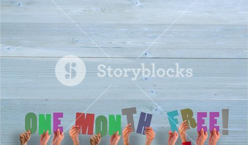 Composite image of hands holding up one month free