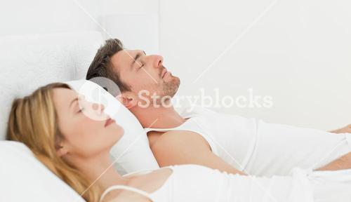 Calm couple sleeping together