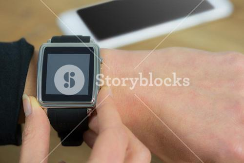 Businesswoman with smart watch on wrist