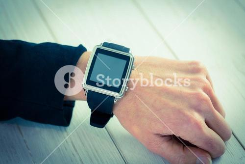 Businesswoman using a smart watch