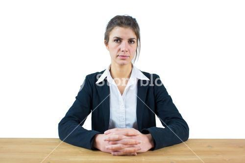 Businesswoman frowning at the camera