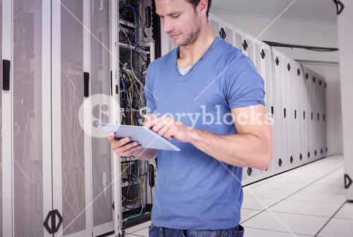 Composite image of man scrolling through tablet pc