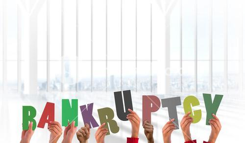 Composite image of hands holding up bankruptcy