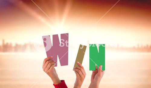 Composite image of hands showing win