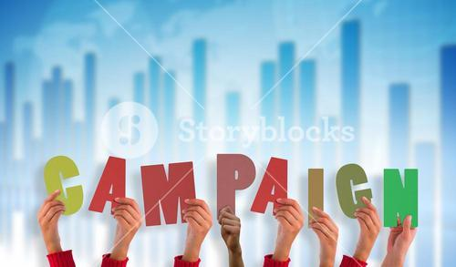 Composite image of hands holding up campaign