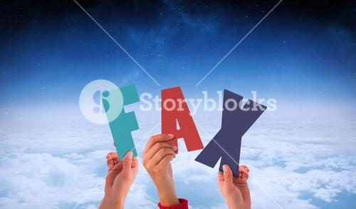 Composite image of hands holding up fax