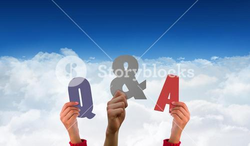 Composite image of hands holding up q and a