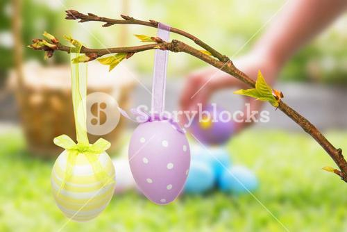 Composite image of little girl collecting easter eggs