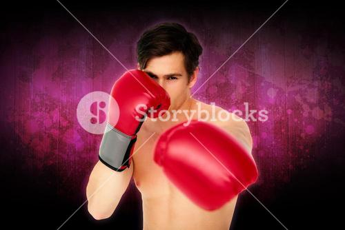 Composite image of tough man wearing red boxing gloves punching to camera
