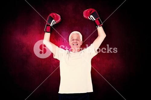 Composite image of senior man in boxing gloves