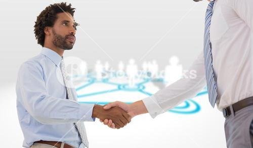 Composite image of young businessmen shaking hands in office