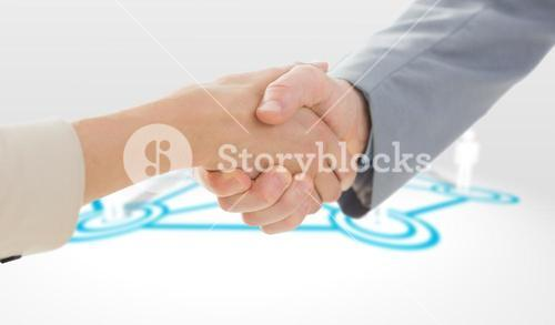 Composite image of closeup of shaking hands after business meeting