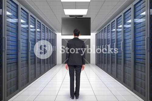 Composite image of businessman turning his back to camera